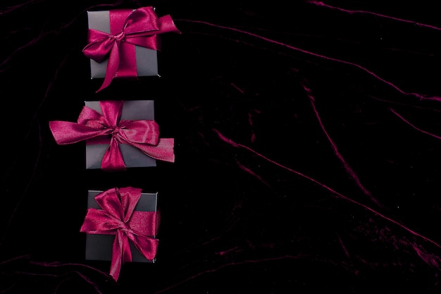 Luxury black gift boxes with pink ribbon