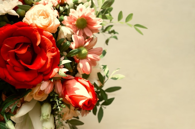 Luxury bouquet of mix flowers on beige, top view