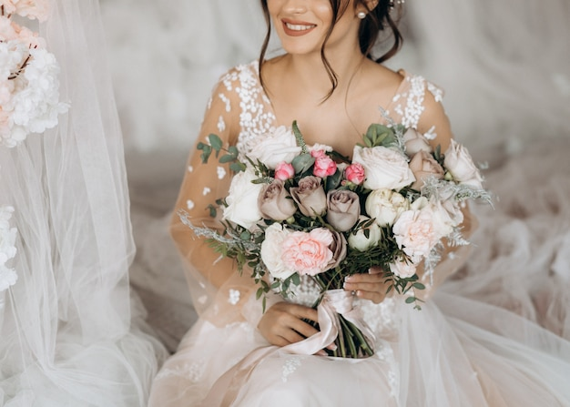 Luxury bride holding a big bouquet of flowers