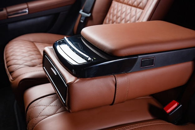 Luxury car interior in brown and black colors