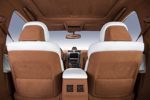 Luxury car interior in brown and white colors