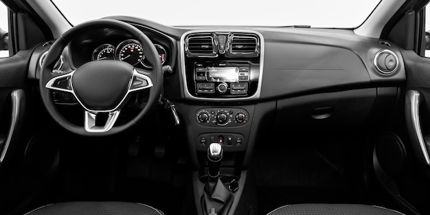 Luxury car interior - steering wheel, shift lever, multimedia  systeme, driver seats and dashboard
