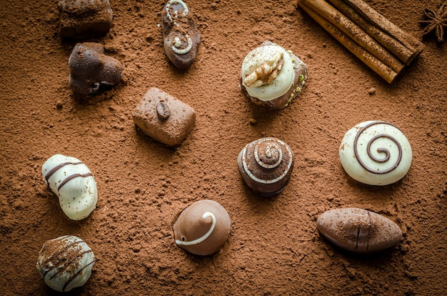 Luxury chocolate candies with cocoa background