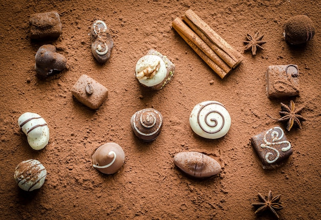 Luxury chocolate candies with cocoa powder