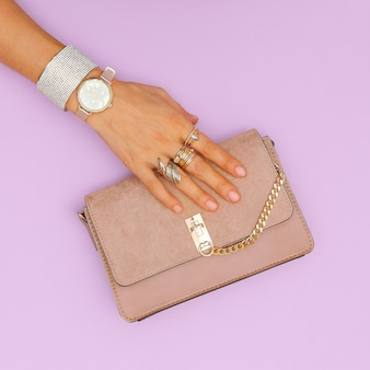 Luxury clutch bag and stylish gold jewelry. trends lady accessories