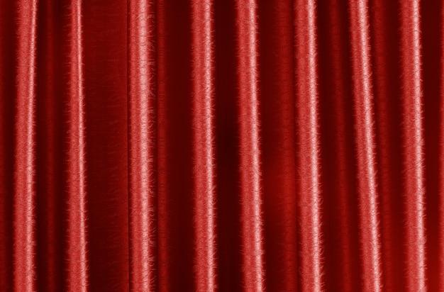Luxury dark red silk curtain texture for background.