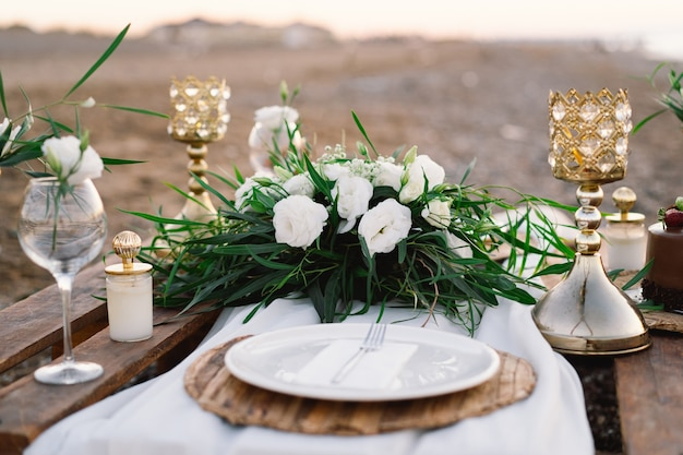 Luxury decorated table for a romantic date festive details tablecloth candles plates glasses