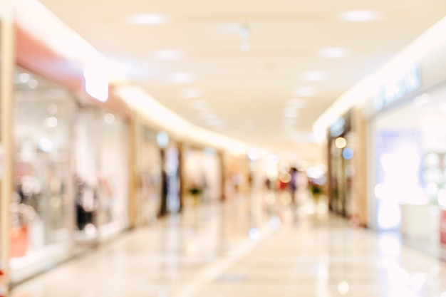 Luxury department store shopping mall interior, abstract defocused blur with bokeh background, concept of shopping seasons design