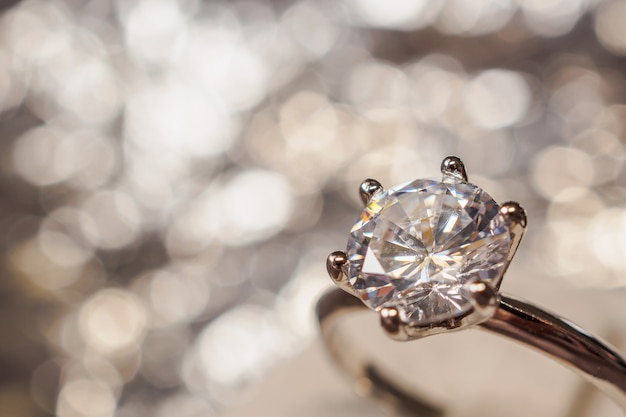 Luxury engagement diamond ring with abstract bokeh light background