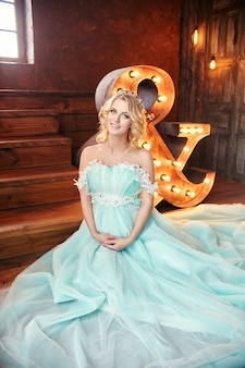Luxury fashion pregnant blond woman wedding dress