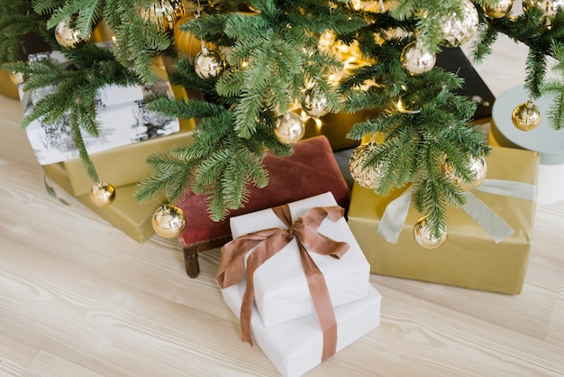 Luxury gift boxes under christmas tree