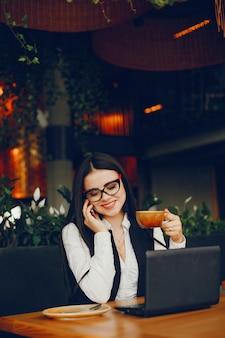 Luxury girl sitting in a restaurant