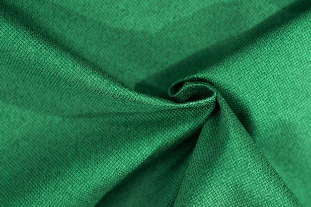 Luxury green fabric sample close-up