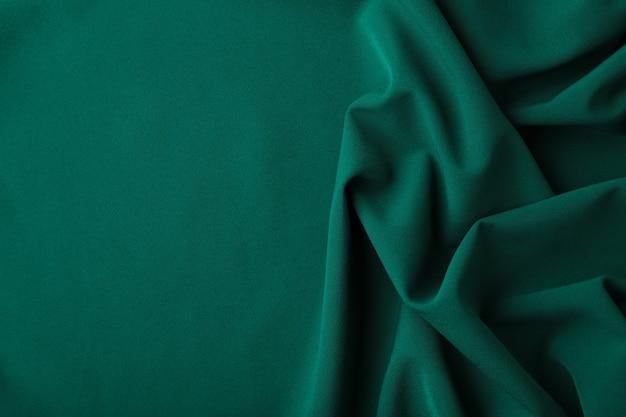 Роскошный зеленый атласный фон. вид сверху