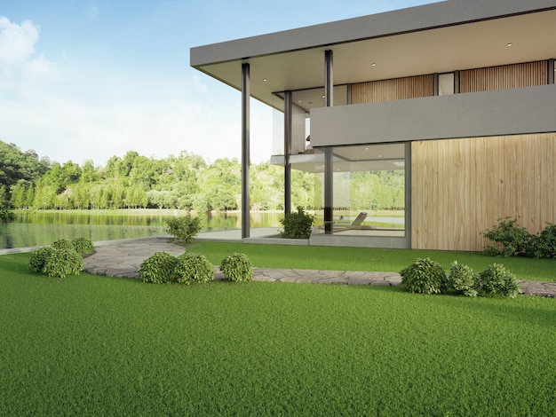 湖の見えるスイミングプールとモダンなデザインのテラス付きの豪華な家。