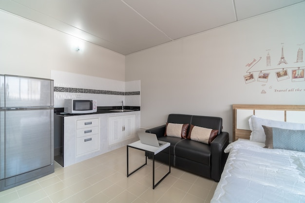 Luxury interior bedroom with leather sofa of living room and kitchen in the same area