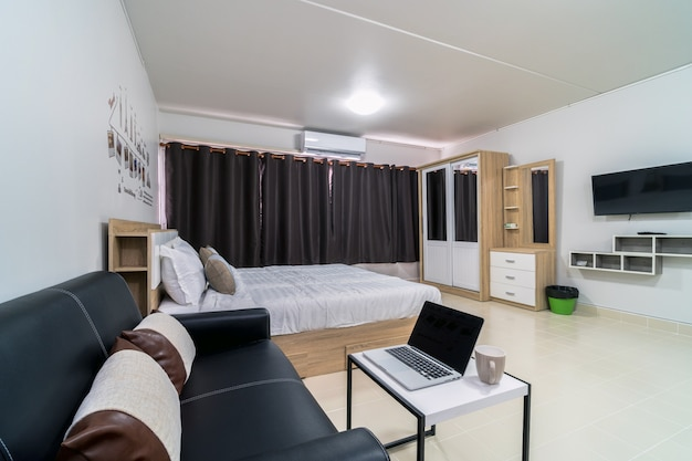 Luxury interior bedroom with leather sofa of living room