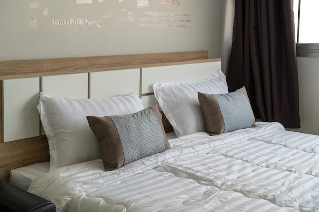 Luxury interior bedroom with pillow, service apartment and accommodations concept