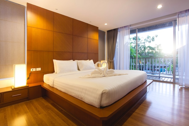 Luxury interior design in bedroom of pool villa with cozy king bed