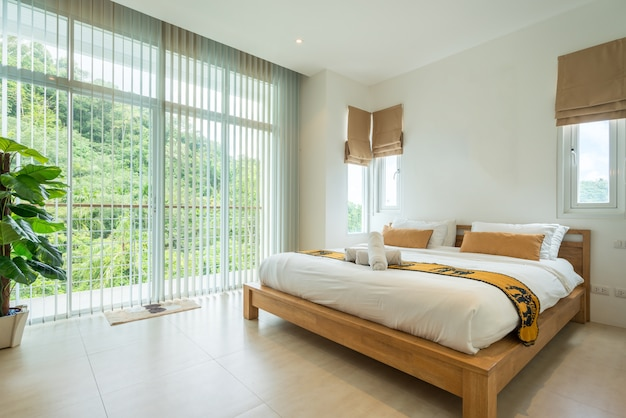 Luxury interior design in bedroom of pool villa with cozy king bed.
