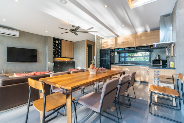 Luxury interior design in kitchen area with feature island counter and dining table