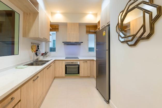 Luxury interior design pool villa in kitchen area whith feature island counter