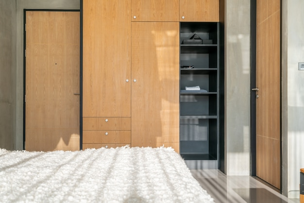 Luxury interior design wardrobe in the bedroom next to the bed