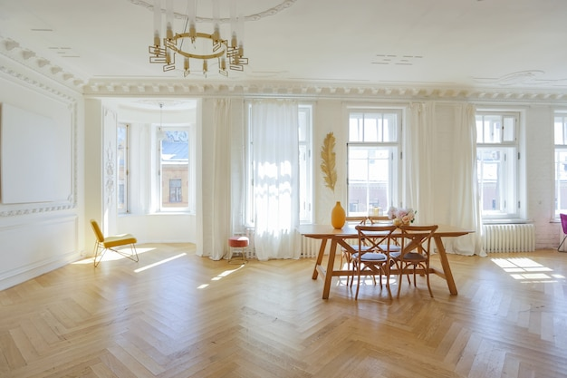 Luxury interior of a spacious apartment in an old 19th century historical house with modern furniture. high ceiling and walls are decorated with stucco