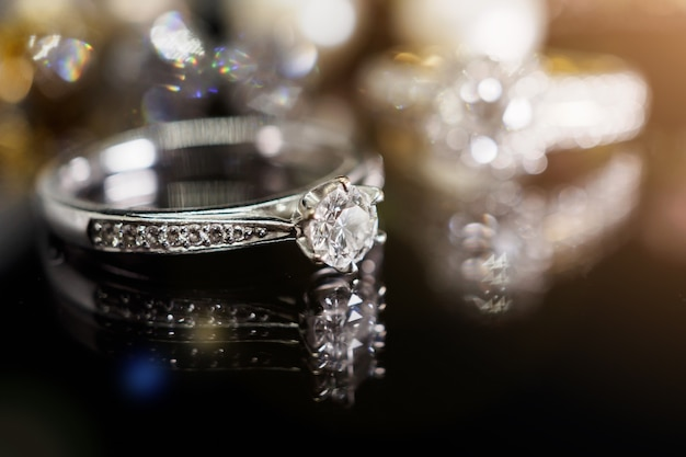Luxury jewelry diamond rings with reflection on black background