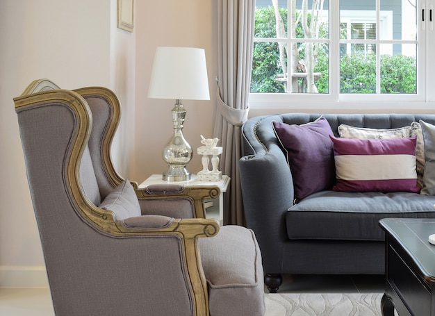 Luxury living room design with classic sofa, armchair and decorative table lamp