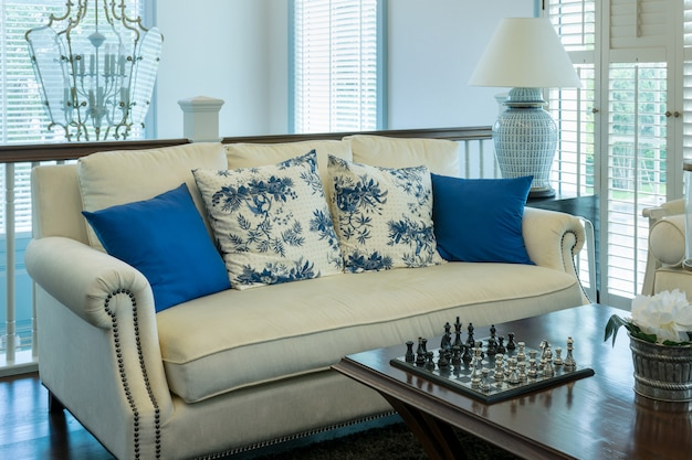 Luxury living room with blue pattern pillows on sofa and decorative chess board