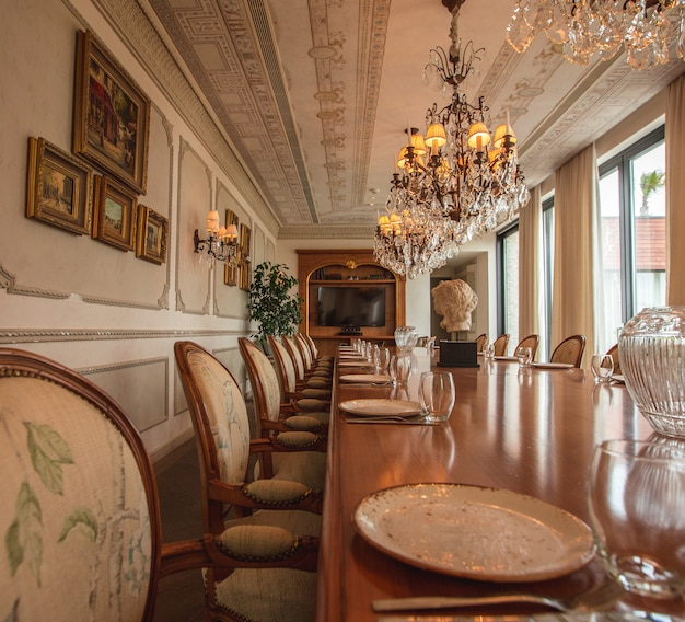 Luxury meeting and dining room table and multiple chairs