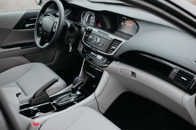 Luxury modern car interior. steering wheel, shift lever and dashboard. detail of modern car interior. automatic gear stick.