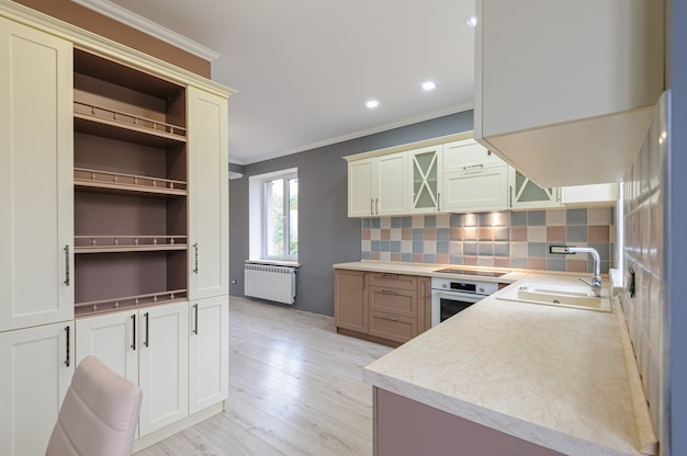 Luxury modern provence styled grey, pink and cream kitchen interior