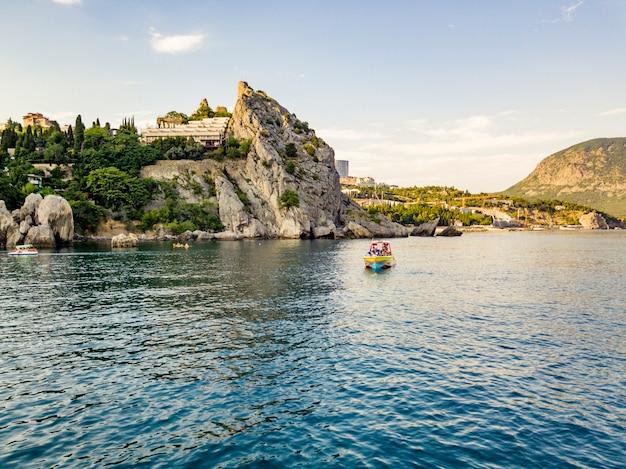 Luxury motor boat near the rock sea coast in europe city bay