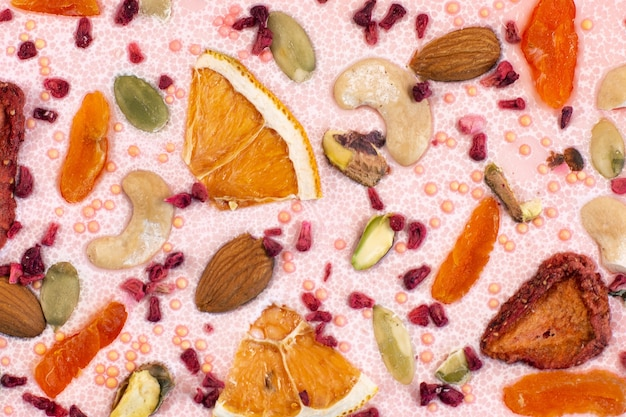 Luxury pink chocolate bar with dried fruits and nuts