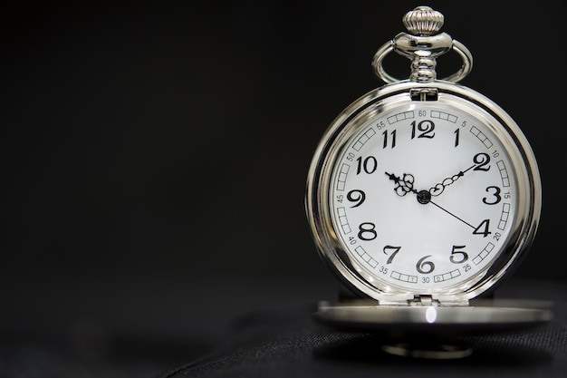 Luxury pocket watch isolated on black