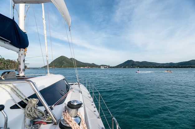 Luxury private yacht cruising in tropical sea on sunny