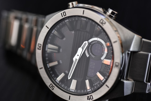 Luxury quartz watch with analog hands and a digital display and a solar battery, tachometer