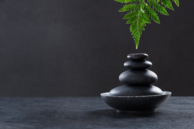 Luxury spa concept with spa stones and fern leaf.
