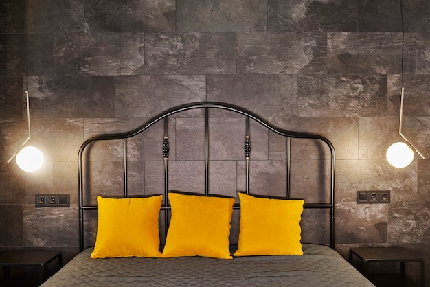 Luxury studio apartment with a free layout in a loft style in dark and yellow colors
