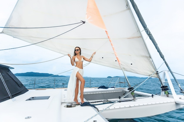 Luxury travel yacht. young woman enjoying the sunny days on the sailing  yacht the sea.
