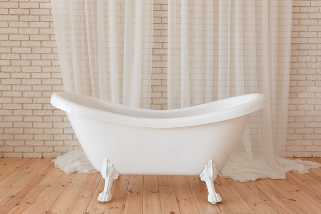Luxury vintage bathtub on white brick background