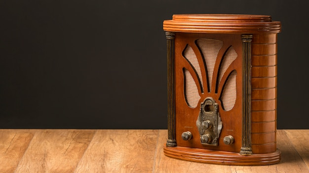 Luxury vintage radio on wooden board copy space