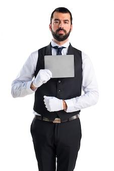 Luxury waiter holding an empty placard