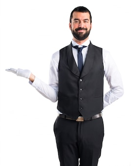 Luxury waiter holding something