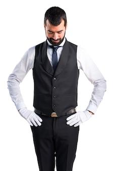 Luxury waiter looking down