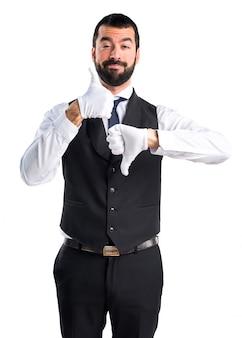 Luxury waiter making good-bad sign