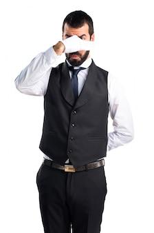 Luxury waiter making smelling bad gesture