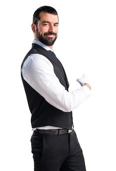 Luxury waiter pointing back